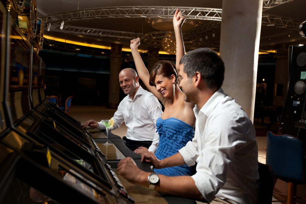 lucky female gambler and male friends celebrating