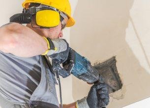 Worker Chiseling Concrete